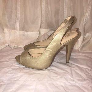 Gold sling back heels